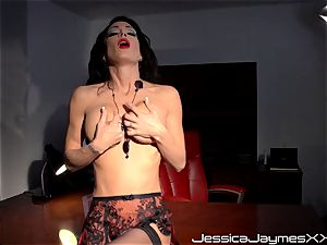 crazy brown-haired Jessica Jaymes fingers her edible snatch pie in her office