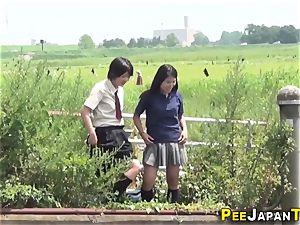 large bush asian urinates