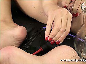 busty Elena Rae urinates thru her tights