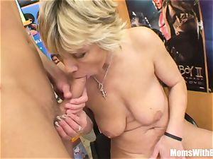 grannie Miluska pulverizing A movie Store Clerk