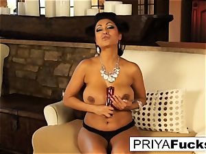 Indian milf Priya taunts then pleases her wondrous moist slot