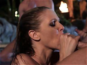 Julia Ann sucks a group of spunk-pumps in a pool