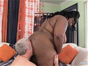 massive dark-hued lady takes massive manstick