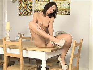 Alexis Brill takes off naked and masturbates on the table