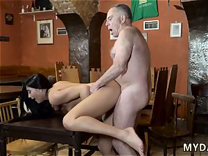 elderly physician pound young saw his father and his girlpatron bare on a table in the middle of