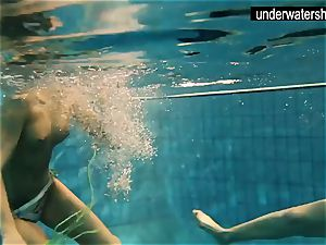 two stellar amateurs demonstrating their bodies off under water