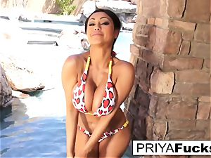 busty Priya Rai gets all wet outside by the pool