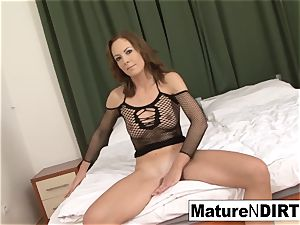 dark-haired cougar wanks before taking a bbc