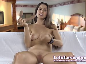 blowing on my fake penis demonstrating how I would deepthroat yours