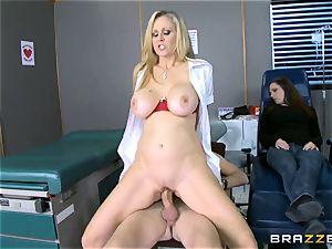 ash-blonde milf Julia Ann sucks a meaty boner as his counterpart sleeps